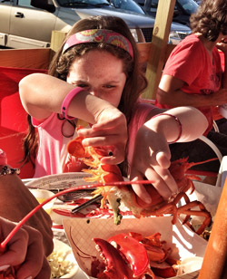 child eating maine lobster